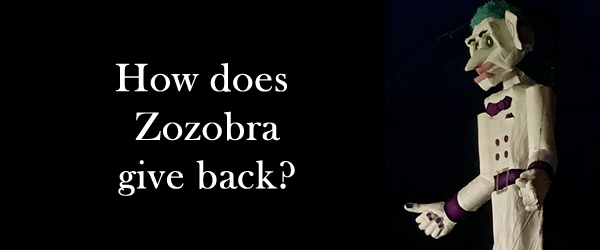 How does Zozobra give back?